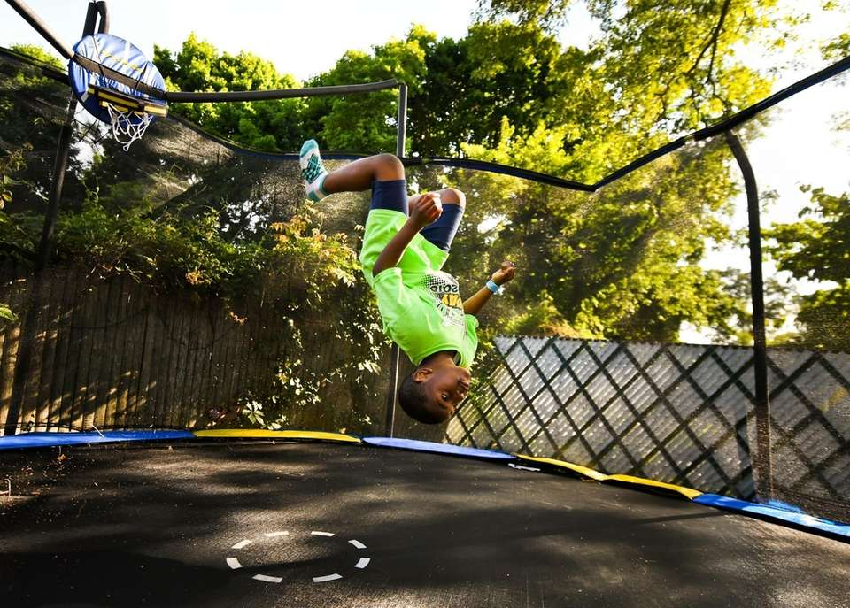 Lamier Lamorissiere, 8, jumps on a trampoline in