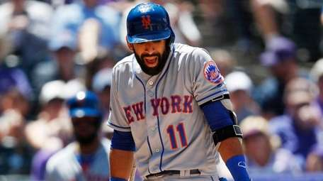 The Mets' Jose Bautista, right, argues with home