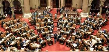 Assembly members vote on bills at the state