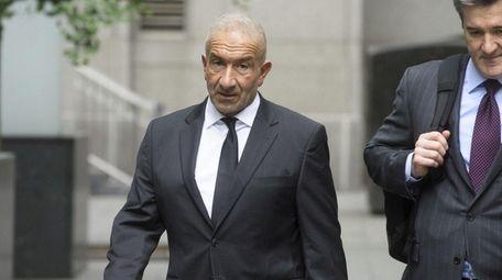 Former SUNY official Alain Kaloyeros, left, arrives Tuesday