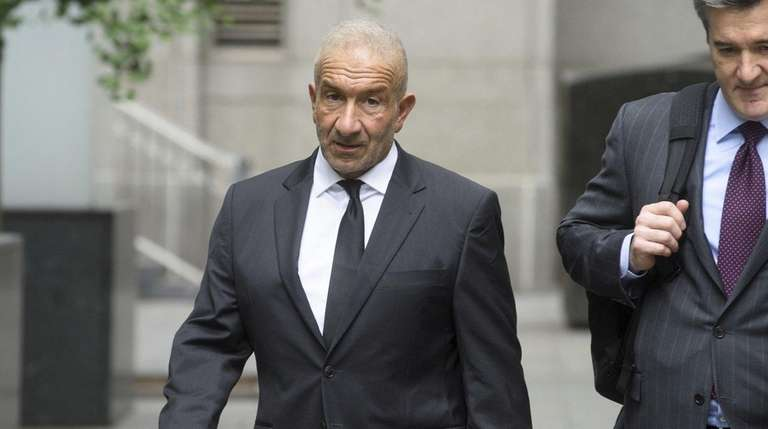 Former SUNY official Alain Kaloyeros, left, arrives Tuesday