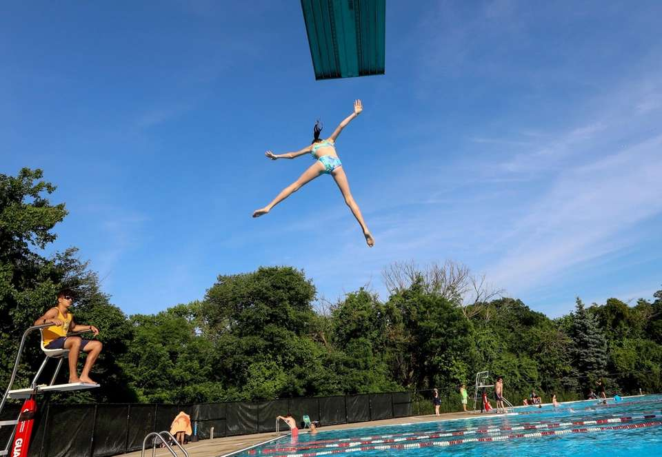 Gia Knee, 11, from Bellmore, jumps off the