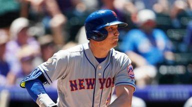 Mets' Brandon Nimmo follows the flight of his