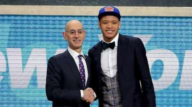 NBA Commissioner Adam Silver poses with the NY