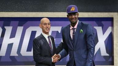 Arizona's Deandre Ayton poses with NBA Commissioner Adam