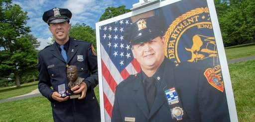Nassau police Officer Richard Rothwell, left, and the