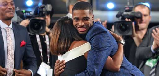 Villanova's Mikal Bridges is greeted by friends and