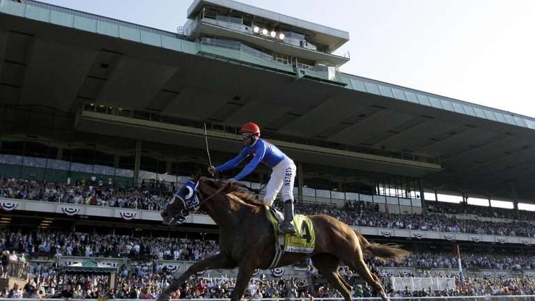 Jockey Kent Desormeaux celebrates aboard Summer Bird after