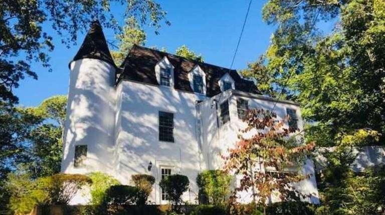 The four-bedroom, two-bathroom Glen Head house features a