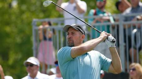 John Smoltz tees off on the first hole