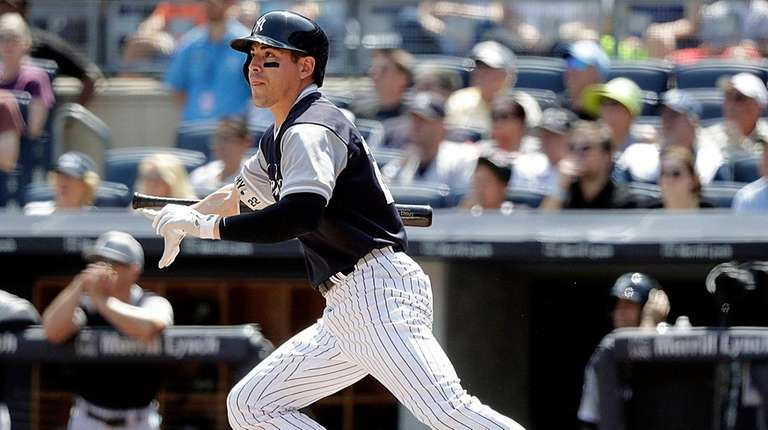 Jacoby Ellsbury follows the flight of his RBI