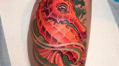 Sea horse cover-up tattoo by Tommy Helm at