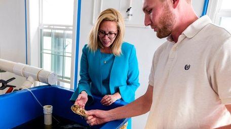 Town Supervisor Laura Gillen tours the shellfish hatchery