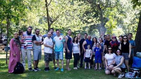 The Akaydin family and friends pose for a