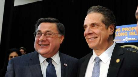 Gov. Andrew Cuomo, right, with Brookhaven town supervisor