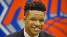 The Knicks' Kevin Knox grins during his introductory