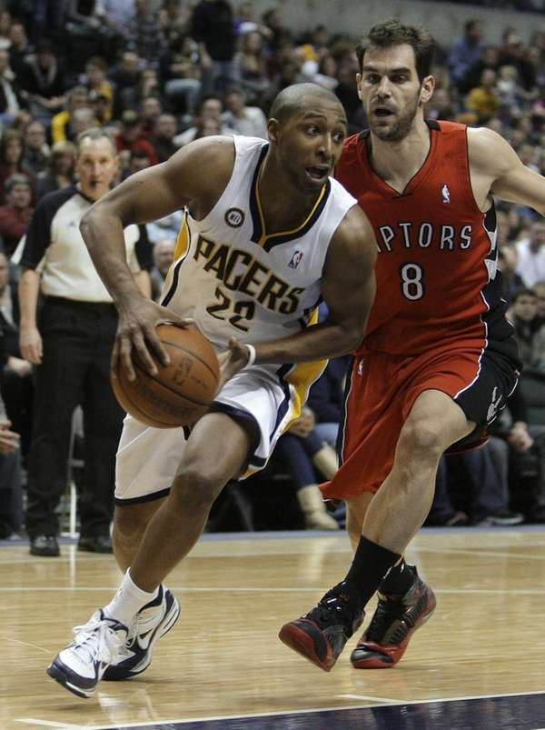 Indiana Pacers guard A.J. Price, left, drives to