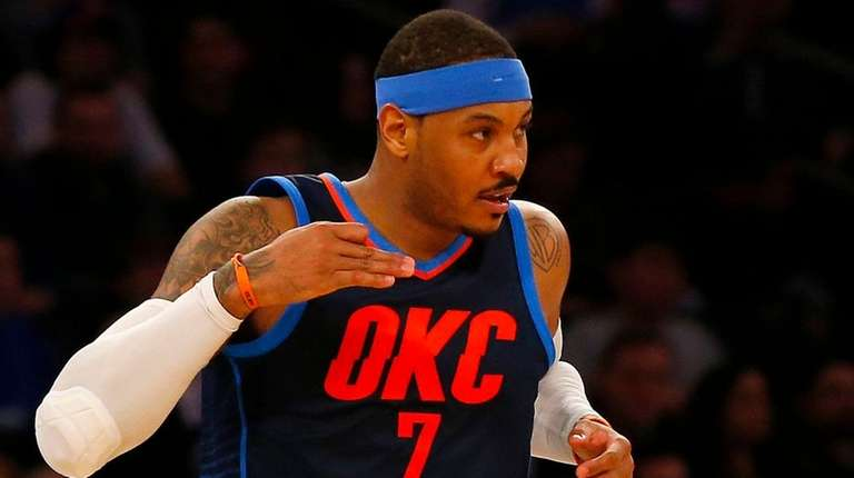 Thunder forward Carmelo Anthony reacts after hitting a