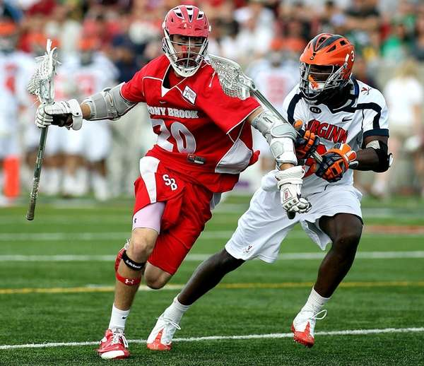 Timmy Trenkle of Stony Brook drives against Virginia's