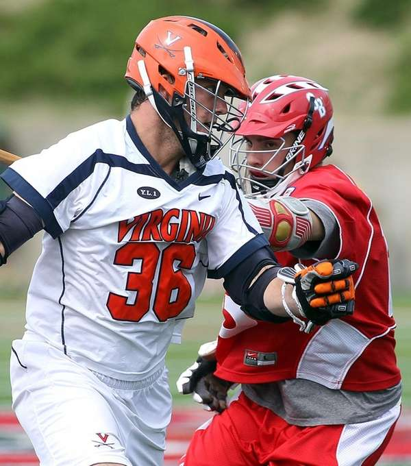 Virginia middie Brian Carroll, left, moves around Stony