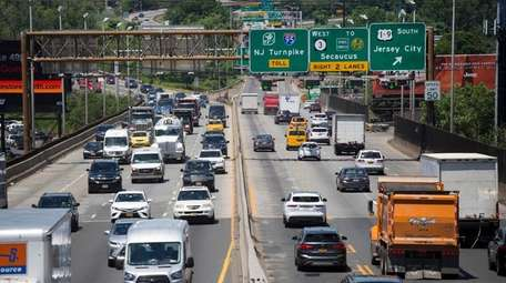 Traffic passes over the Route 495 viaduct on