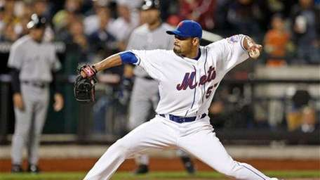 Mets pitcher Johan Santana winds up in the