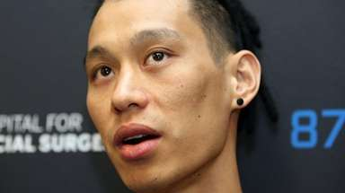 Nets' Jeremy Lin talks to media during day