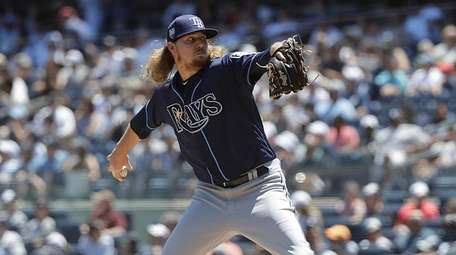 Tampa Bay Rays relief pitcher Ryne Stanek delivers