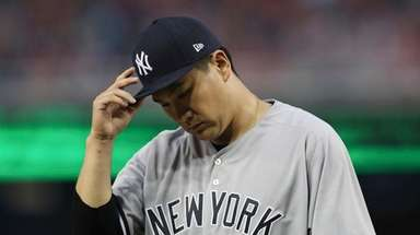 Yankees starting pitcher Masahiro Tanaka walks back to