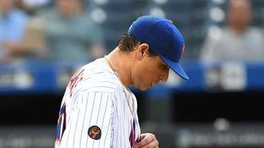 Mets starting pitcher Jason Vargas reacts in the