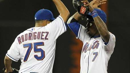 The Mets' Francisco Rodriguez and Jose Reyes celebrated