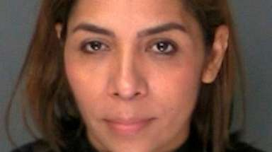Yolanda Martinez-Reymundo, 41, of Mastic Beach, was charged