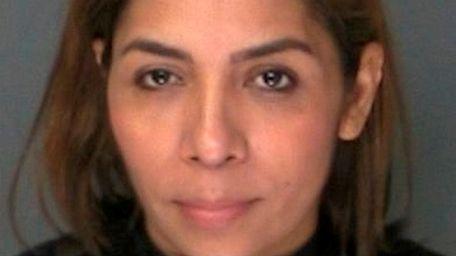 Yolanda Martinez-Reymundo, 41, of Mastic Beach, was charged
