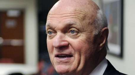 Then-Devils general manager Lou Lamoriello talks to the