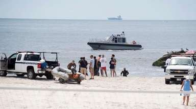 Police divers search for the body of the