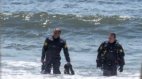 Nassau County police divers come out of the
