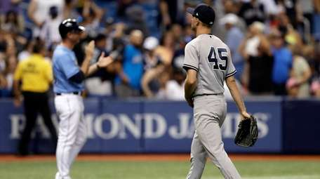 Yankees relief pitcher Chasen Shreve walks off after