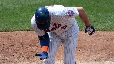 Brandon Nimmo reacts after being hit by