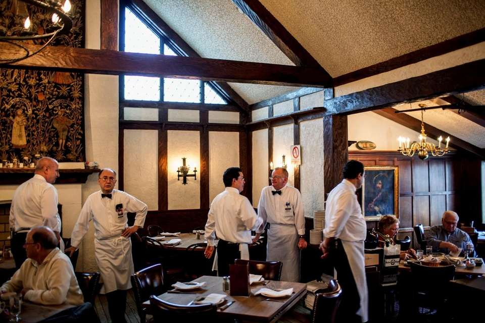 Waiters watch over tables at Peter Luger Steak