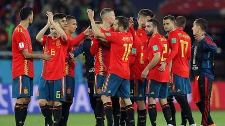 Spain players celebrate following the 2018 FIFA World