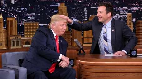 Jimmy Fallon's playful moment mussing President Donald Trump's