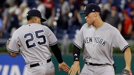 The Yankees' Gleyber Torres, left, and Aaron Judge