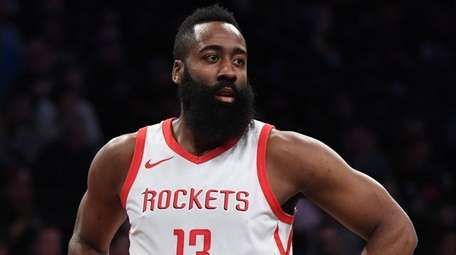 Rockets guard James Harden looks on against the