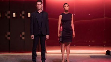 Simon Quarterman and Thandie Newton in a scene