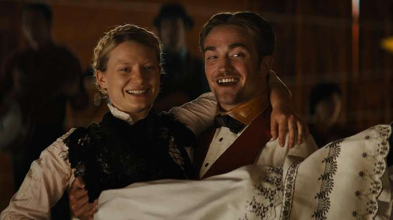 Mia Wasikowska and Robert Pattinson star in the