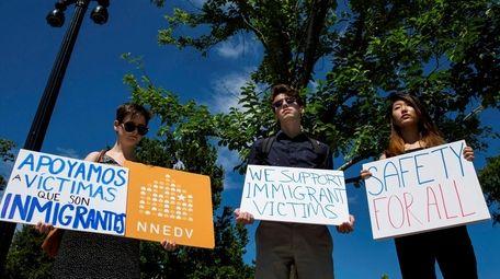 WASHINGTON, DC - JUNE 26: People protest outside