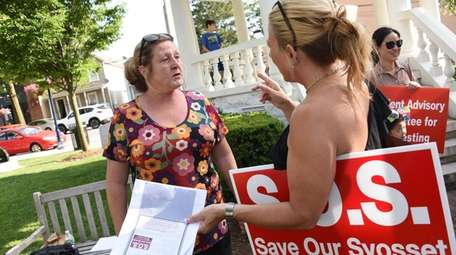 Lorraine Burnard, 57, of Hicksville, left, joined opponents