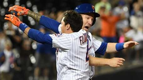 Mets first baseman Wilmer Flores celebrates his walk-off,