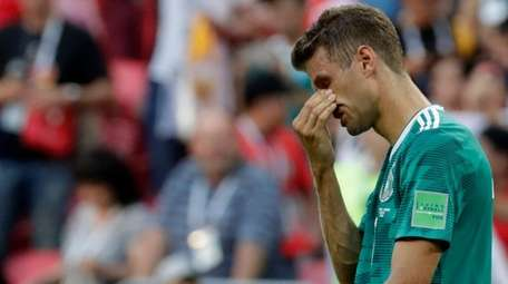 Germany's Thomas Mueller wipes his face after the
