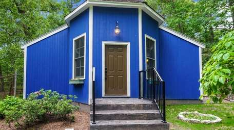 A tiny house in Commack, listed for $449,990.